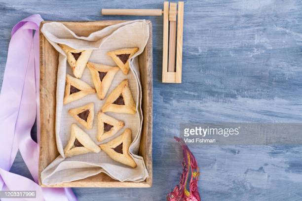 jewish hamantaschen homemade biscuits or cookies with chocolate - judaism stock pictures, royalty-free photos & images