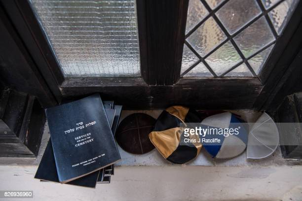 Jewish head covers also known as kippah are seen next to books of Jewish cemetery service in the prayer hall of the funerary buildings at Willesden...