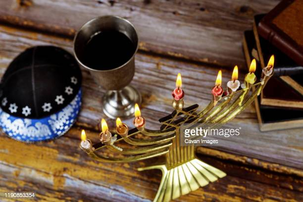 jewish holiday hanukkah with menorah in the festival - hannukkah stock pictures, royalty-free photos & images