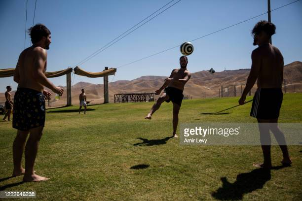 Jewish Israeli men play soccer in the Israeli settlement of Vered Yericho in the West Bank Jordan Valley on June 24, 2020 in Vered Yericho, West...