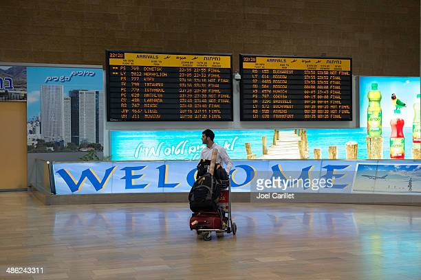 jewish man arriving at airport in israel - ben gurion airport stock pictures, royalty-free photos & images