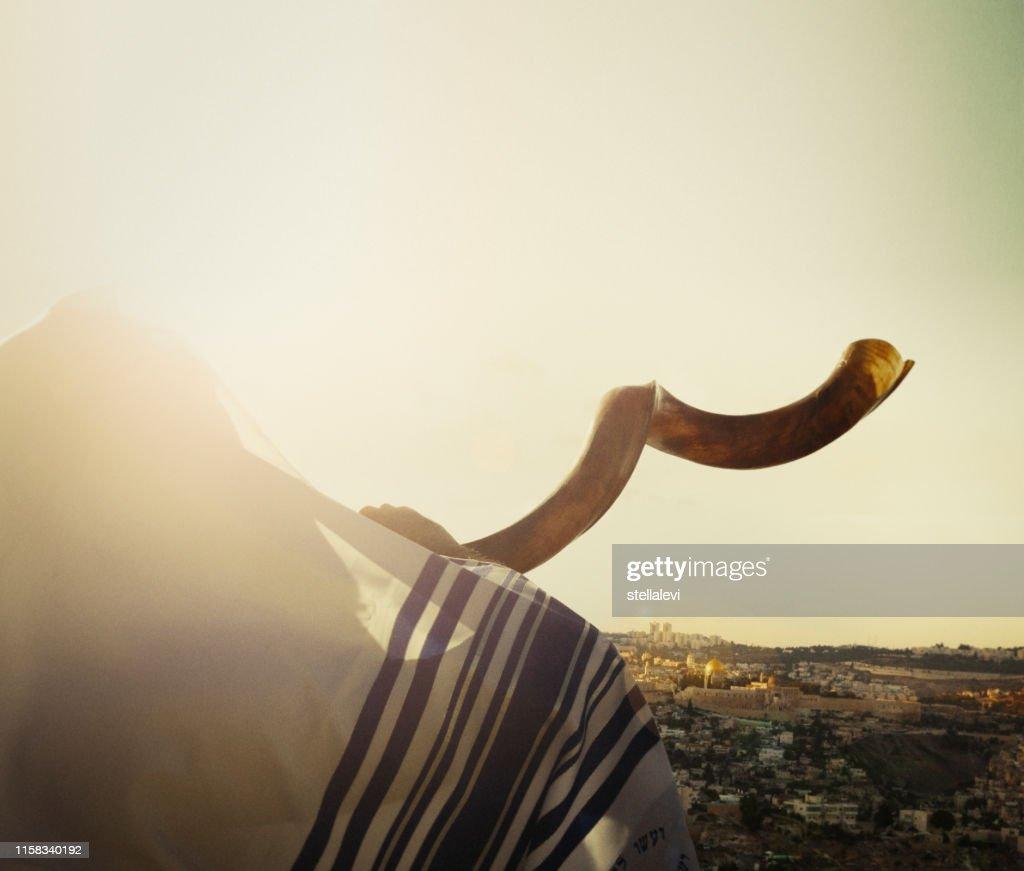 Jewish man blowing the Shofar in Jerusalem : Stock Photo