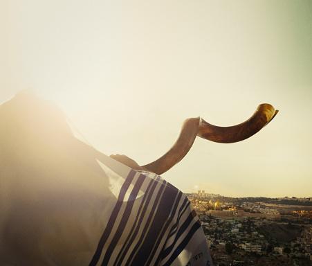 Jewish man blowing the Shofar in Jerusalem 1158340192