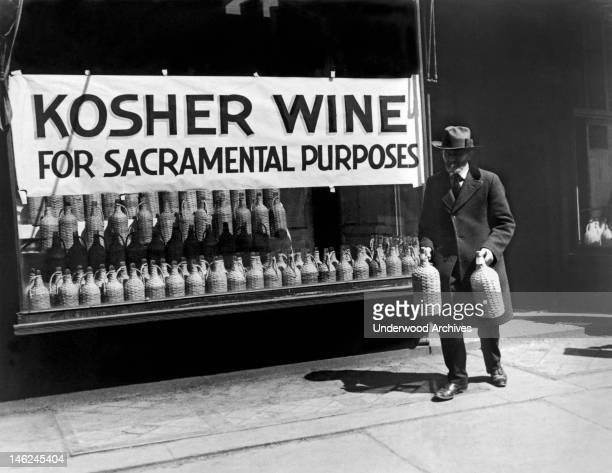 A Jewish man buying kosher wine for sacramental purposes New York New York early to mid 20th century