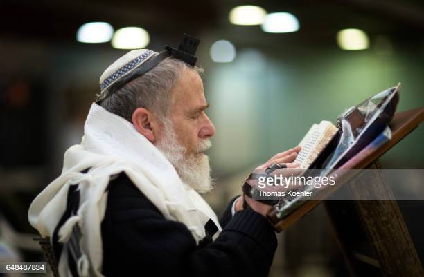 A Jewish man is praying in a hallway next to the Wailing Wall in the historic city center of Jerusalem on February 08 2017 in Jerusalem Israel