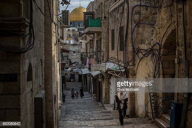 Jewish man is seen walking through the Old City during shabbat the Jewish day of rest and seventh day of the week on January 14 2017 in Jerusalem...