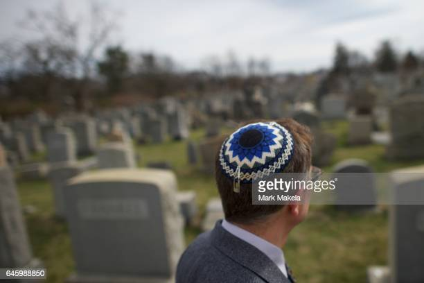 Jewish man looks at vandalized tombstones at Mount Carmel Cemetery February 27 2017 in Philadelphia Pennsylvania Police are investigating 75100...