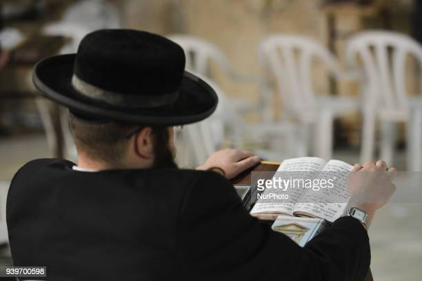 A Jewish man praying at the Western Wall inside the Old City in Jerusalem Wednesday 14 March 2018 in Jerusalem Israel