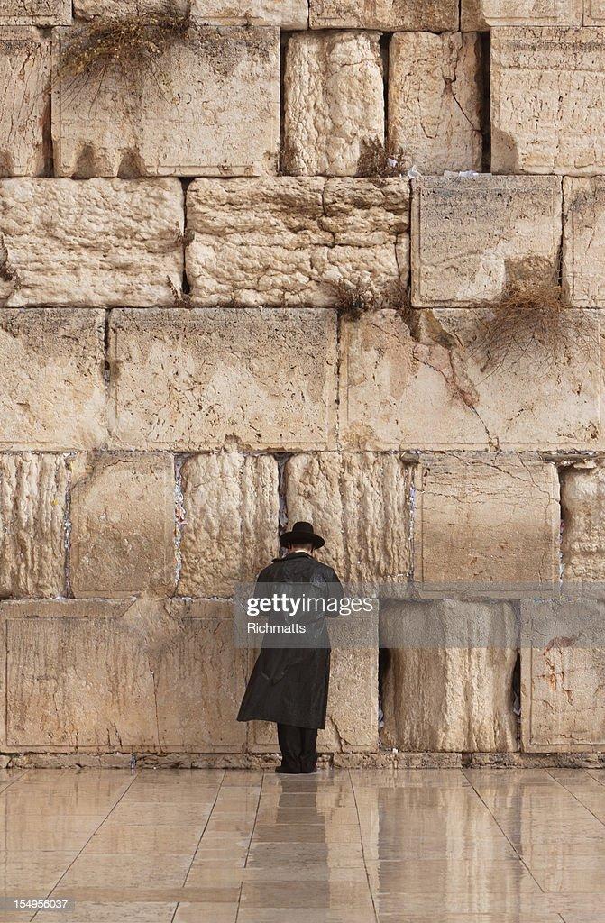 Jewish man praying on the Wailing Wall in Jerusalem : Stock Photo