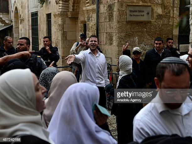 Jewish man reacts in front of the Palestinian women during a tension moment between Israeli security forces and Palestinian Muslims near Al Aqsa...