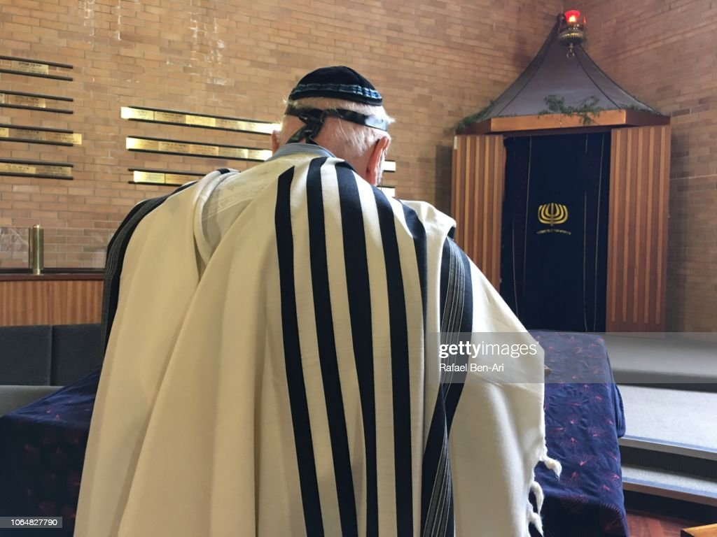 Jewish Man Reading and Praying from a Torah Scroll : Stock Photo