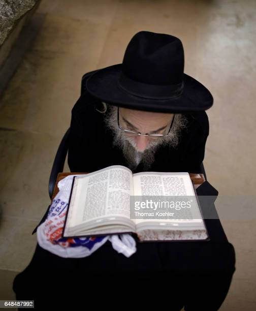 A Jewish man reads in the Holy Scripture Tanach in a hallway next to the Wailing Wall in the historic city center of Jerusalem on February 08 2017 in...