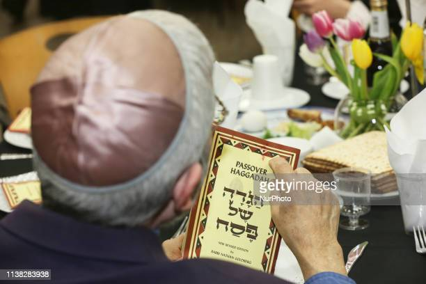 Jewish man reads passages from the Passover Haggadah during a Passover seder in North York Ontario Canada on April 19 2019