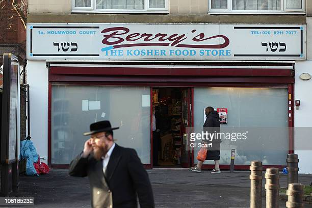 Jewish man walks past a Kosher food store in the Stamford Hill area of north London on January 19 2011 in London England The residents of Stamford...