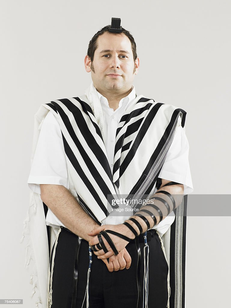 Jewish man wearing tallit and teffillin for prayers : Stock Photo