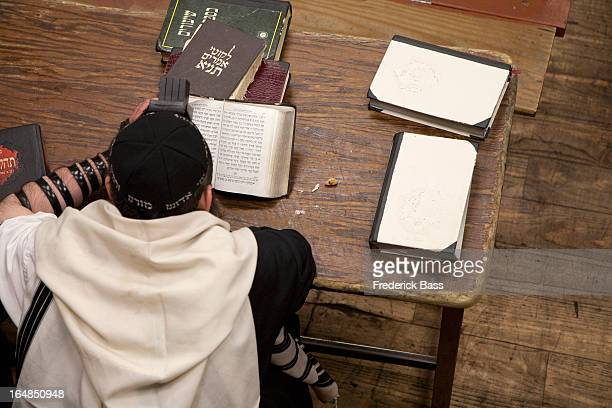 jewish man with tefillin reading religious prayer book - jewish prayer shawl ストックフォトと画像