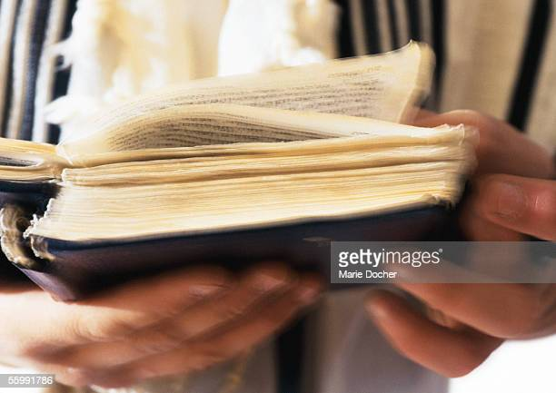 jewish man's hands holding torah, close-up - torah stock pictures, royalty-free photos & images