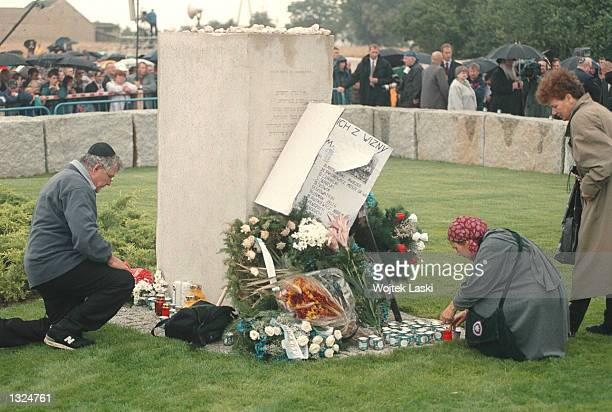 Jewish men and women lay flowers to commemorate a new memorial for victims July 10 2001 during a ceremony in the place where 60 years ago in 1941...