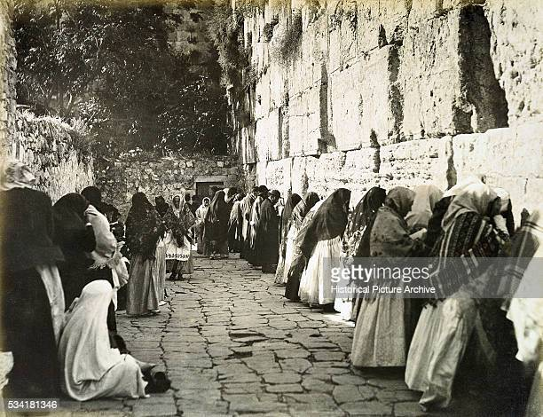 Jewish men and women pray at the Western Wall in the old city of Jerusalem in about 1905