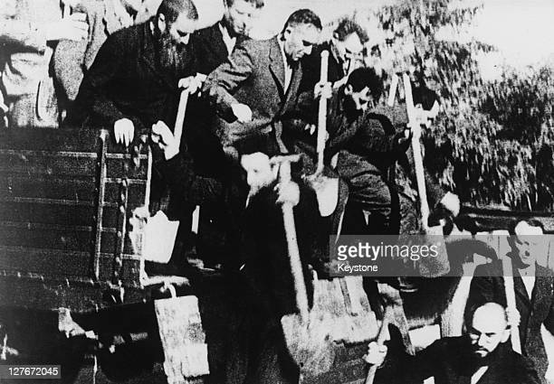 Jewish men arrive for forced labour as demolition workers in Nazioccupied Poland circa 1940