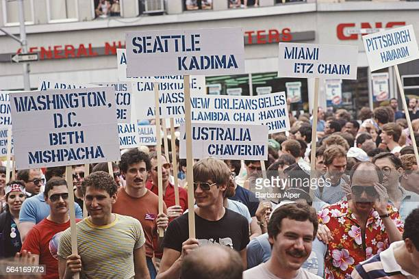 Jewish men marching with signs during the Gay Pride parade in New York City USA June 1982
