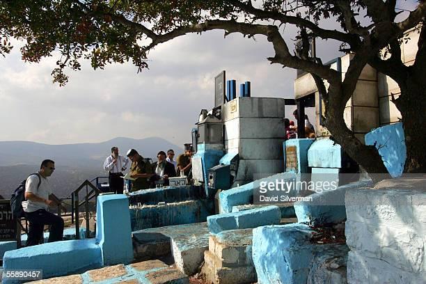 Jewish men pray at the tomb shrine of Rabbi Yitzhak Luria a 16thcentury Jewish mystic and Kabbalah scholar October 10 2005 in the northern Israeli...