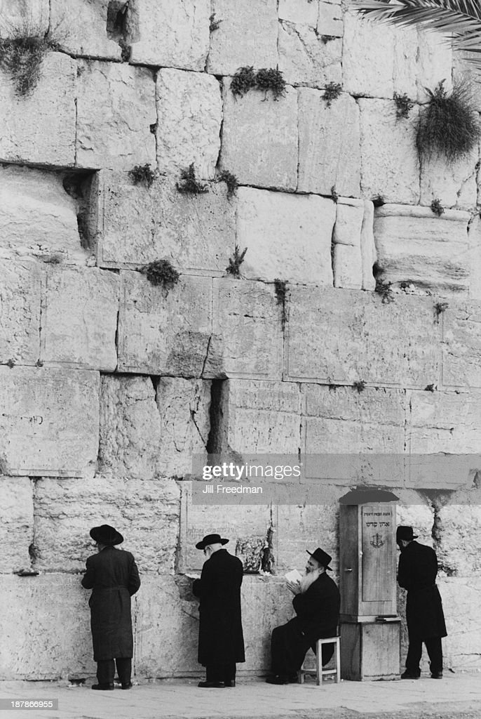 Jewish men pray at the Wailing Wall one month after the Six
