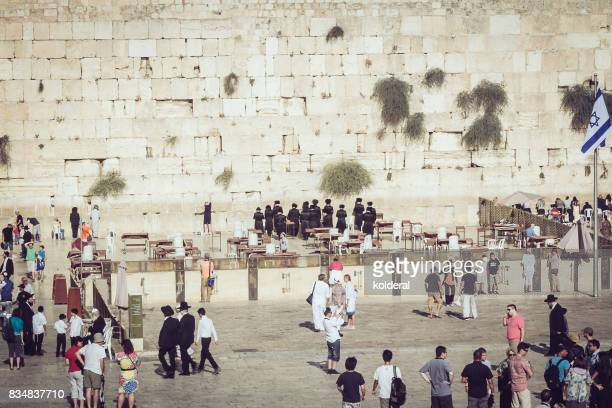 jewish men praying at the western wall of the temple on the temple mount - jewish prayer shawl stock pictures, royalty-free photos & images