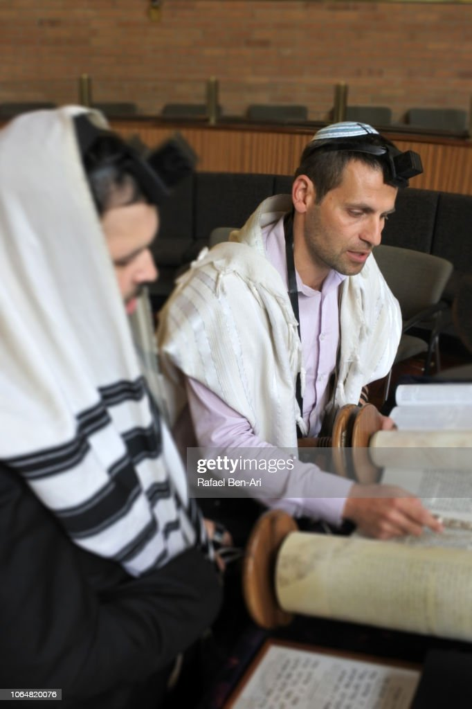 Jewish Men Reading and Praying from a Torah Scroll : Stock Photo