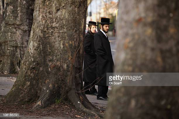 Jewish men wait to cross the street in the Stamford Hill area of north London on January 19 2011 in London England The residents of Stamford Hill are...