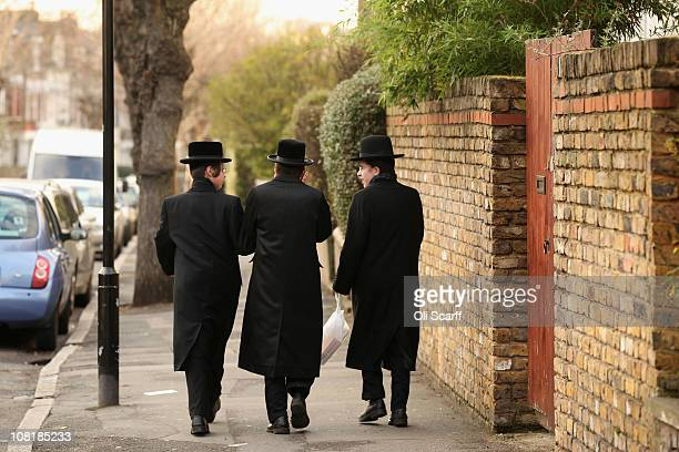 Jewish men walk along the street in the Stamford Hill area of north London on January 19 2011 in London England The residents of Stamford Hill are...