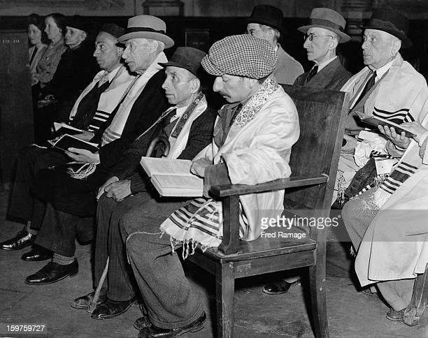 Jewish men wearing the tallit a striped prayer shawl attend a synagogue in Berlin for the first time in years September 1945 The man nearest the...
