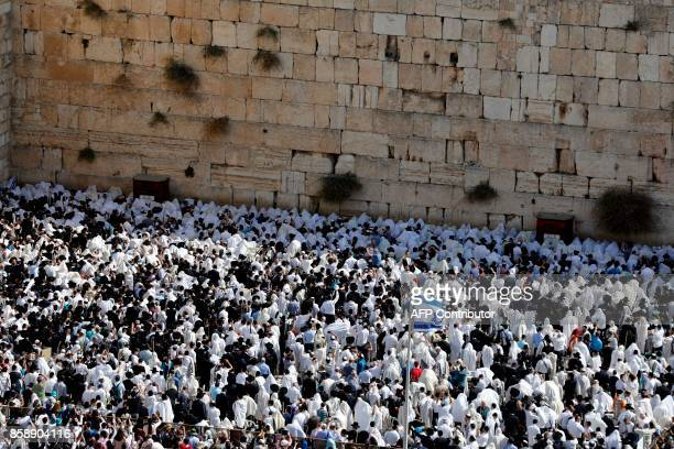 Jewish men wearing traditional Jewish prayer shawls known as Tallit perform the annual Cohanim prayer during the Sukkot holiday or the feast of the...