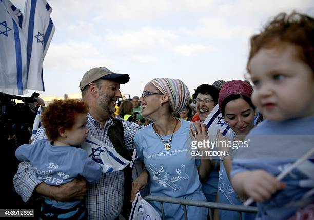 Jewish new immigrants from North America who are making Aliyah reunite with their relatives upon their arrival at Ben Gurion International airport on...