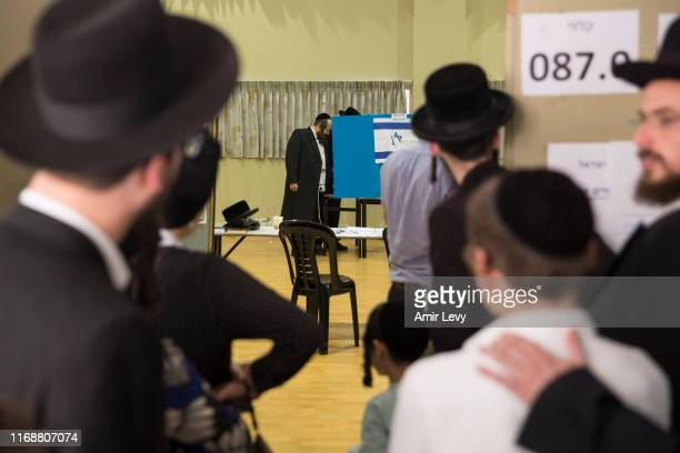 Jewish Orthodox men wait in line to cast their vote on September 17 2019 in Bnei Brak Israel Israelis are heading to the polls for a second time this...