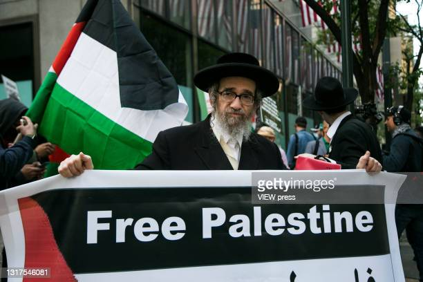 Jewish orthodox pro-Palestinian man takes part in a protest near the Israeli consulate in Midtown Manhattan demanding an end to the aggression...