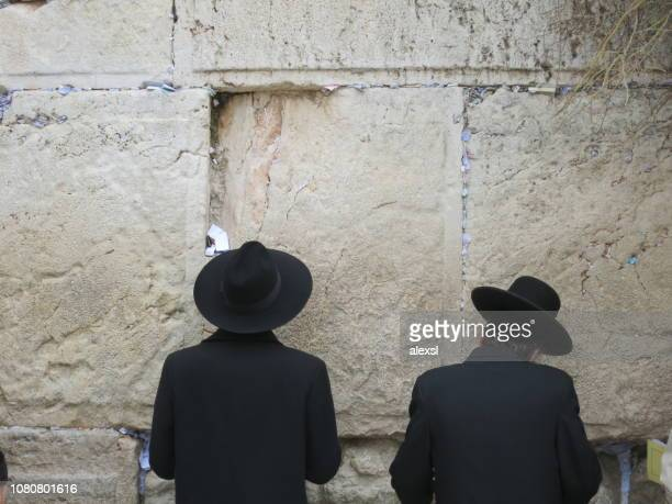 jewish people are praying at wailing wall in jerusalem old city - historical palestine stock pictures, royalty-free photos & images