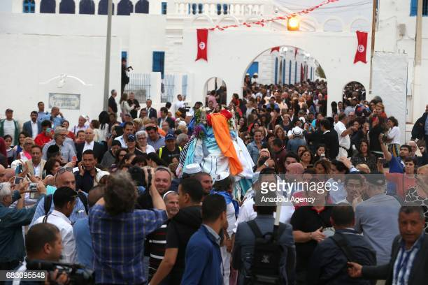 Jewish people around the world gather during El Ghriba festival at the El Ghriba Synagogue on the island of Djerba Tunisia on May 14 2017