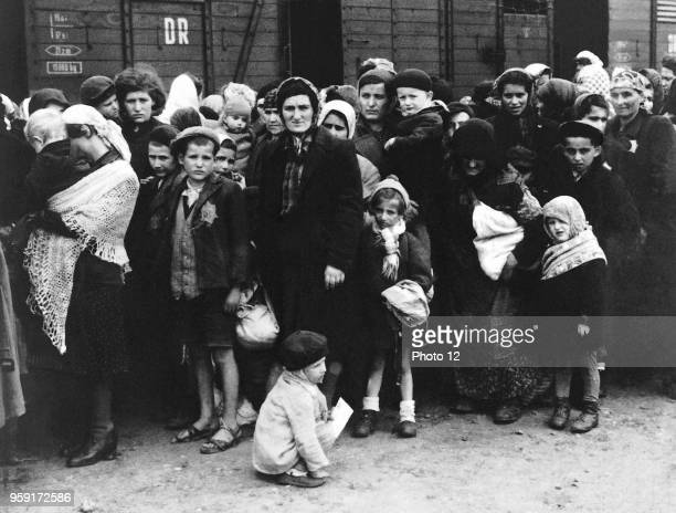 Jewish people in front of a train for deportation to a concentration camp