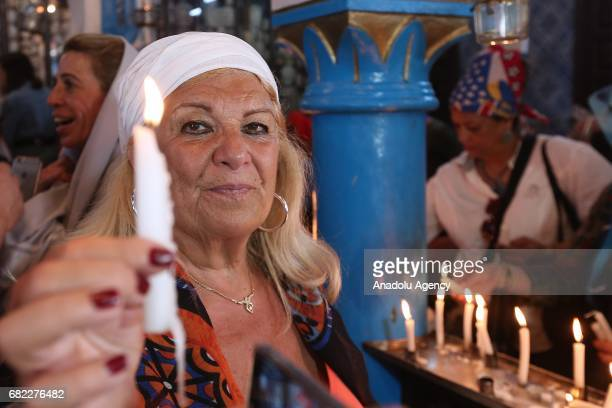 Jewish pilgrims from Tunisia and around the world light candles and pray as they observe their annual pilgrimage at El Ghriba Synagogue the oldest...