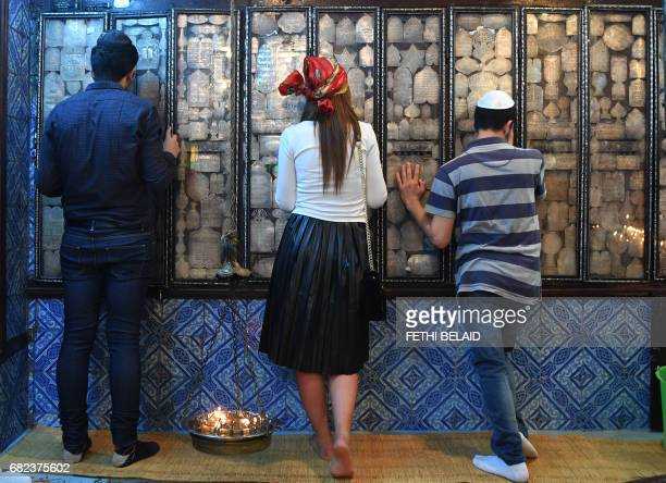 Jewish pilgrims pray at the Ghriba synagogue in the Tunisian resort island of Djerba on May 12 2017 during the first day of the annual Jewish...