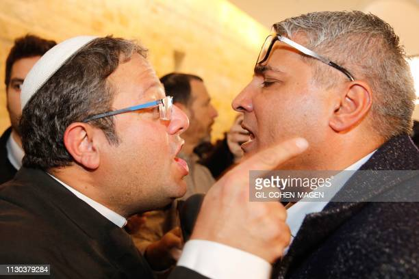 TOPSHOT Jewish Power party's Itamar Ben Gvir argues with the Israeli Arab candidate Ata Abu Medeghem of RaamBalad after a hearing at the Israeli...
