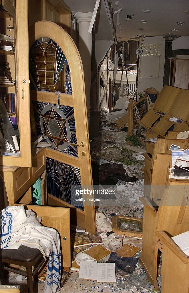 Jewish Prayer Shawls And Prayer Books Lie Strewn Among Broken Furniture  Inside The Bomb Damaged