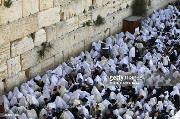 Jewish priests and religious men wearing Talit take part in the Cohanim prayer during the Passover holiday at the Western Wall in the Old City of...