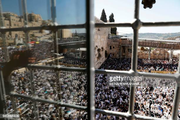 TOPSHOT Jewish priests and religious men wearing Talit take part in the Cohanim prayer during the Passover holiday at the Western Wall in the Old...