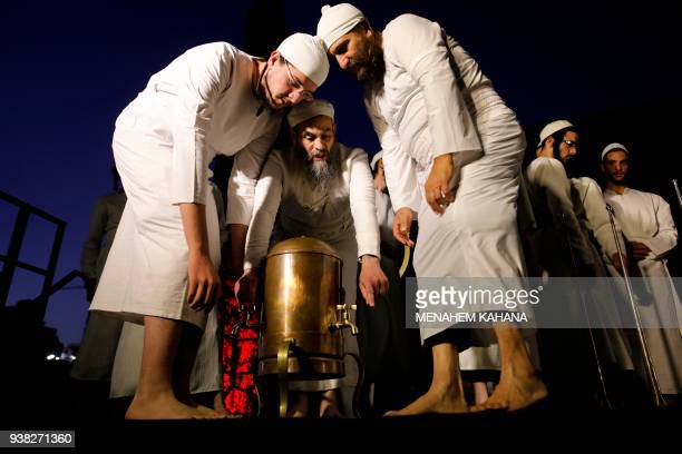 Jewish priests known as Cohanim who advocate for the construction of the third Temple wear traditional ceremonial garments and wash their feet as...