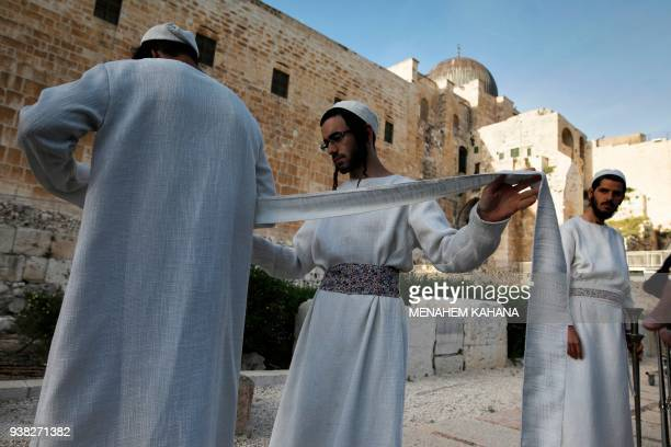 Jewish priests known as Cohanim who advocate for the construction of the third Temple dress in traditional ceremonial garments as they follow...
