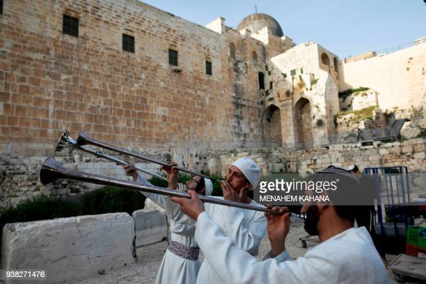 Jewish priests known as Cohanim who advocate for the construction of the third Temple blow trumpets and wear traditional ceremonial garments as they...