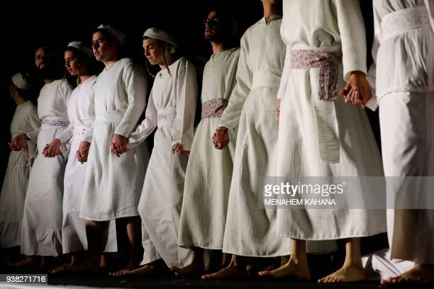 Jewish priests known as Cohanim who advocate for the construction of the third Temple wear traditional ceremonial garments as they follow biblical...