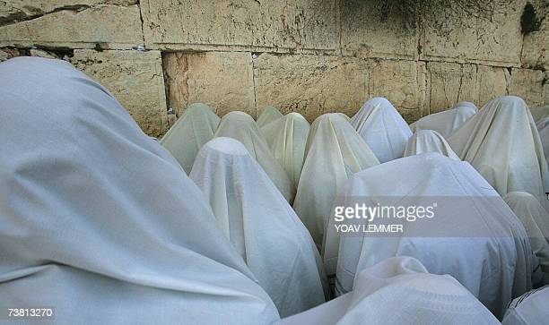 Jewish priests or Cohanim cover their heads and faces with the their Talit or prayer shawl as they take part in a blessing for the Jewish people at...